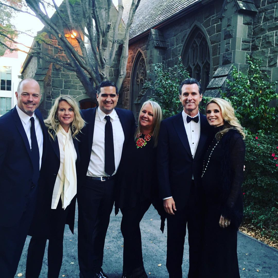 Lori Puccinelli Stern poses with her friends at a wedding last winter. From left to right: Geoff Callan, Hilary Newsom Callan, Stern, and her husband Peter, Gavin Newsom, and Jennifer Siebel Newsom