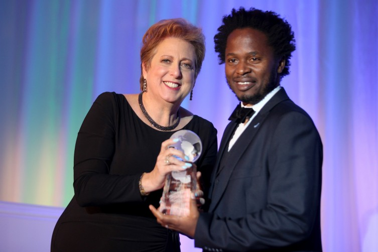SAN FRANCISCO, CA - OCTOBER 07:  Caryl Stern, President & CEO of UNICEF USA (L) and Ishmael Beah, Spirit of Compassion Award Honoree at the inaugural UNICEF Gala San Francisco at the Ritz Carlton on October 7, 2017 in San Francisco, United States.  (Photo by Kelly Sullivan/Getty Images for UNICEF USA)