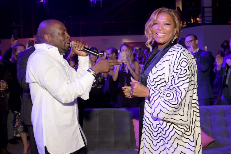 Wyclef Jean sings to Queen Latifah