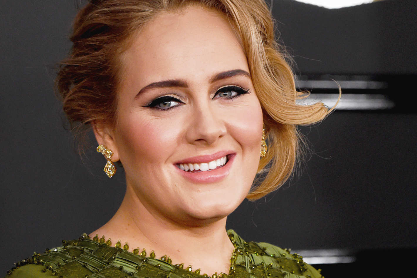 Adele relies on Troy Surratt for her radiant visage.