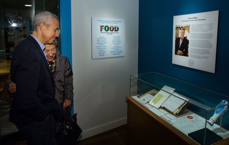 Danny Meyer and his mother viewing his contributions to the Smithsonian Food History Weekend Exhibit.