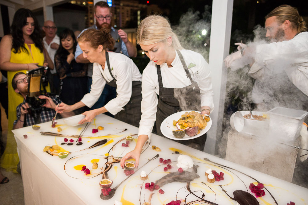Chefs prepare an interactive meal at a Supper Club event