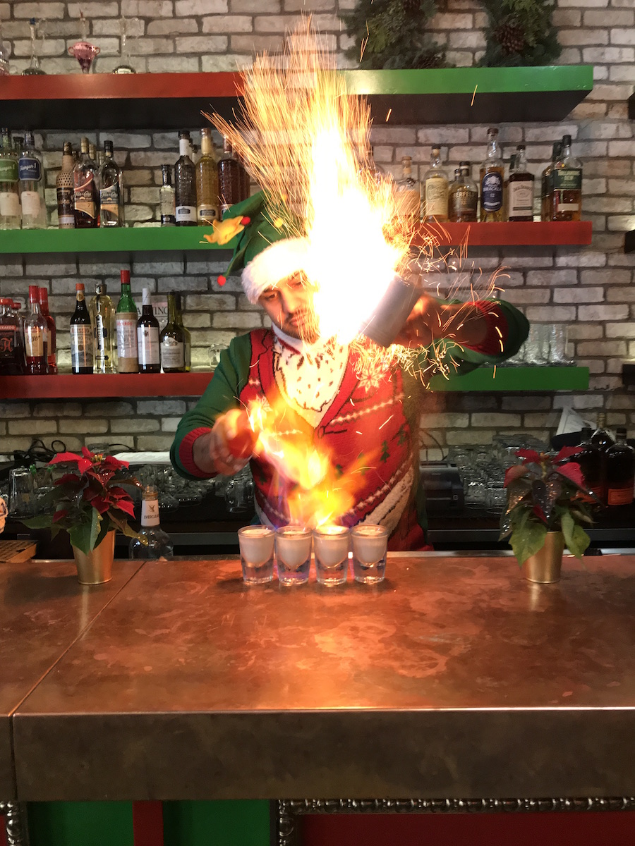 Shaher Misif mixes a drink at Deck the Halls