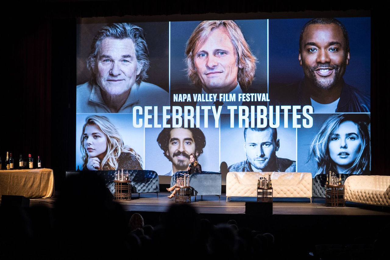 Natalie Morales on stage at the Celebrity Tribute Ceremony