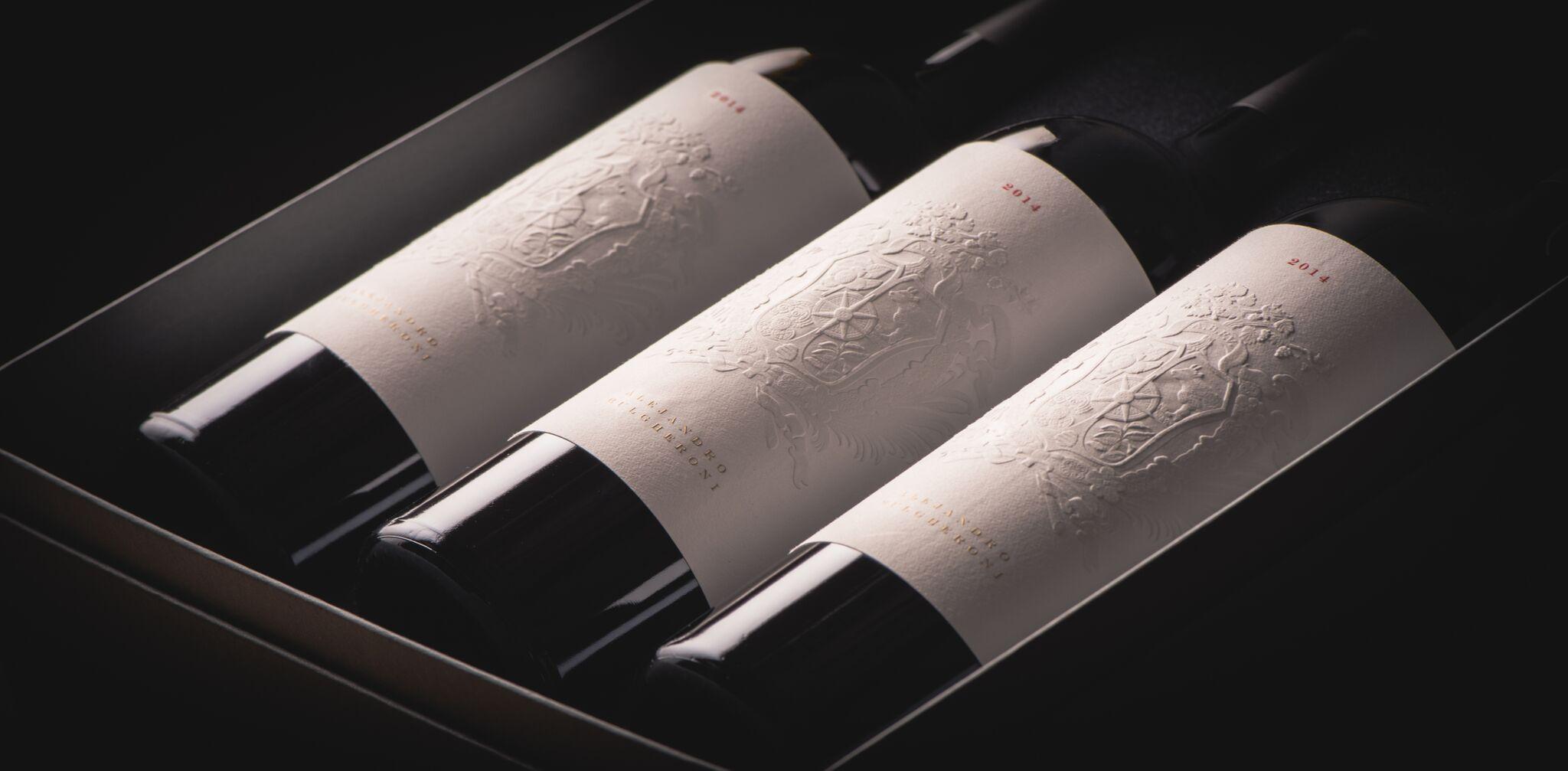The wine bottles have letterpress labels