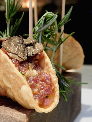 Black Angus Steak Tartare Taco topped with Black Truffle, and served with Truffle Aioli