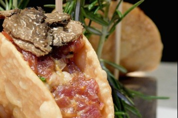 Black Angus Steak Tartare Taco topped with Black Truffle, and served with Truffle Aioli[1]