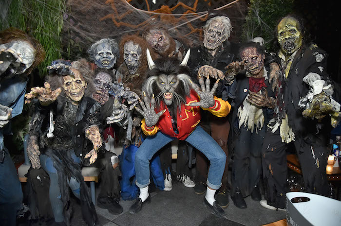 Heidi Klum (C) poses with her zombies as she enters Heidi Klum's 18th annual Halloween Party presented by Party City at the Magic Hour Rooftop Bar & Lounge on October 31, 2017 in New York City.