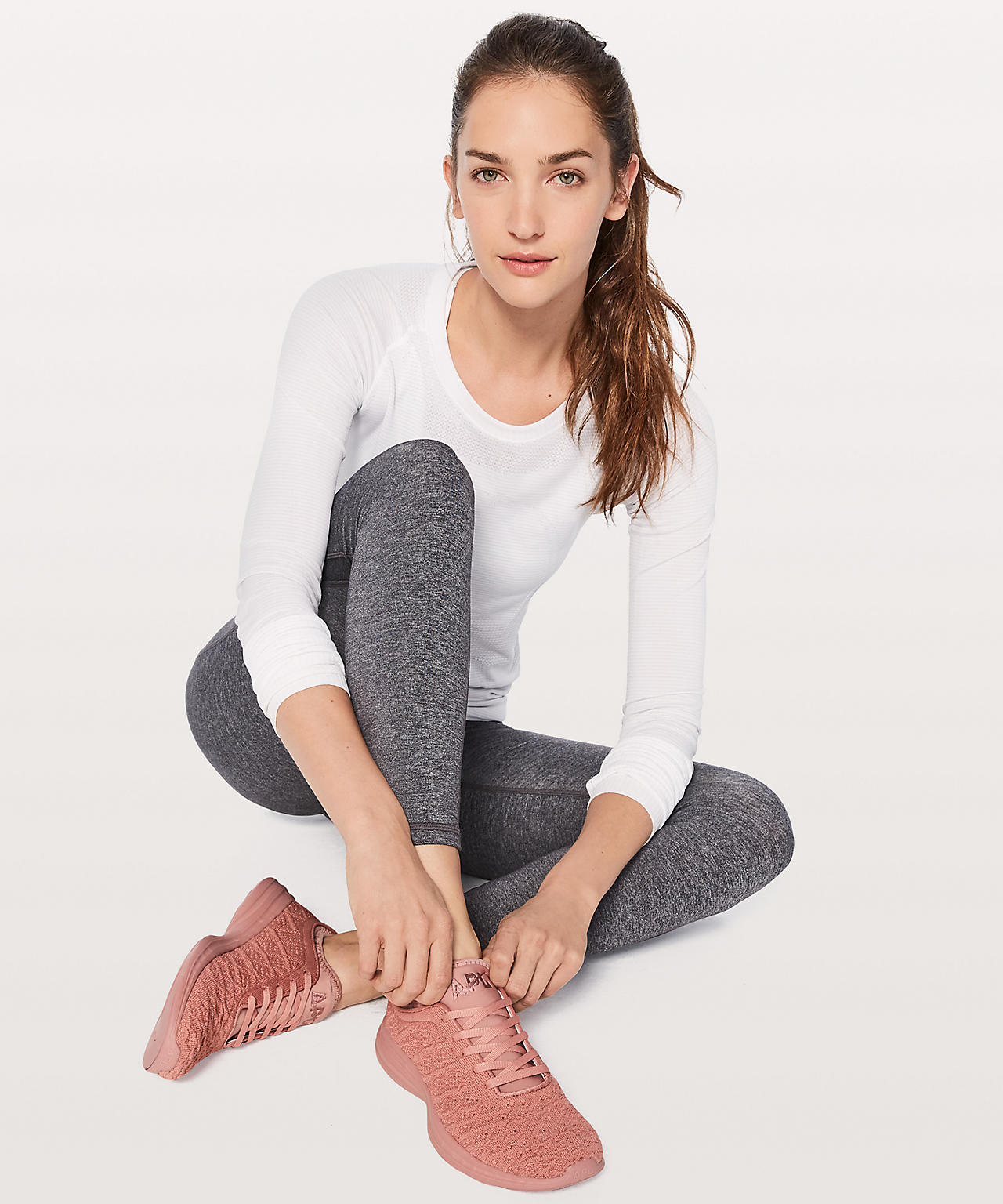 A model wearing Lululemon and APL