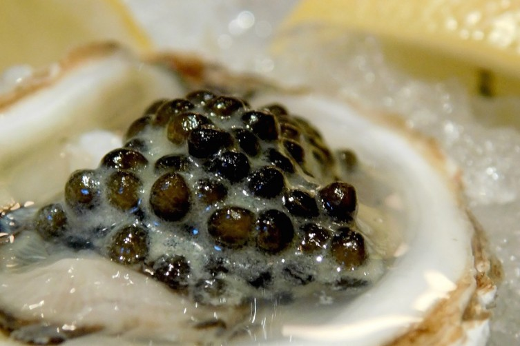 Oyster topped with Black Caviar