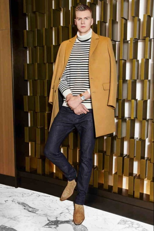 Turtleneck and coat: MR. P Jeans: ALBA Taupe boot: SAINT LAURENT Watch: JAQUET DROZ