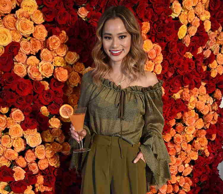 Jamie Chung poses with the signature cocktail for the 2018 Golden Globes, The Moet 75