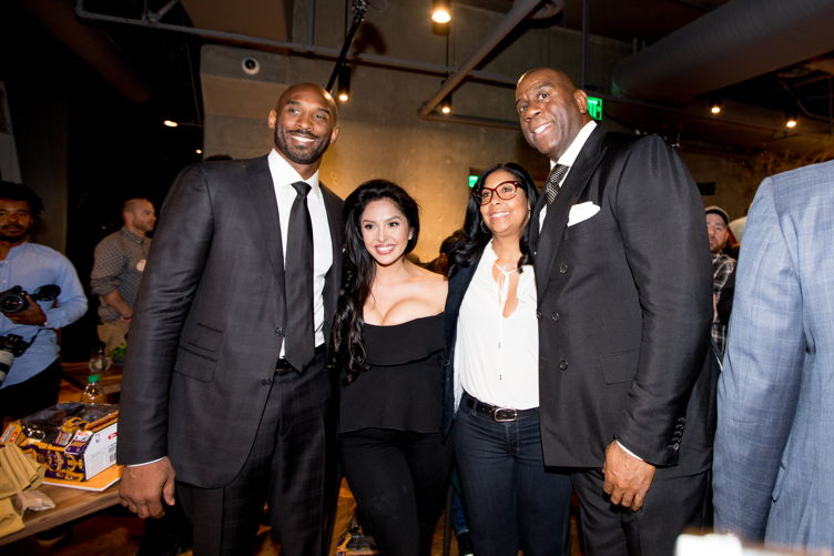 Kobe and Vanessa Bryant with Cookie and Magic Johnson