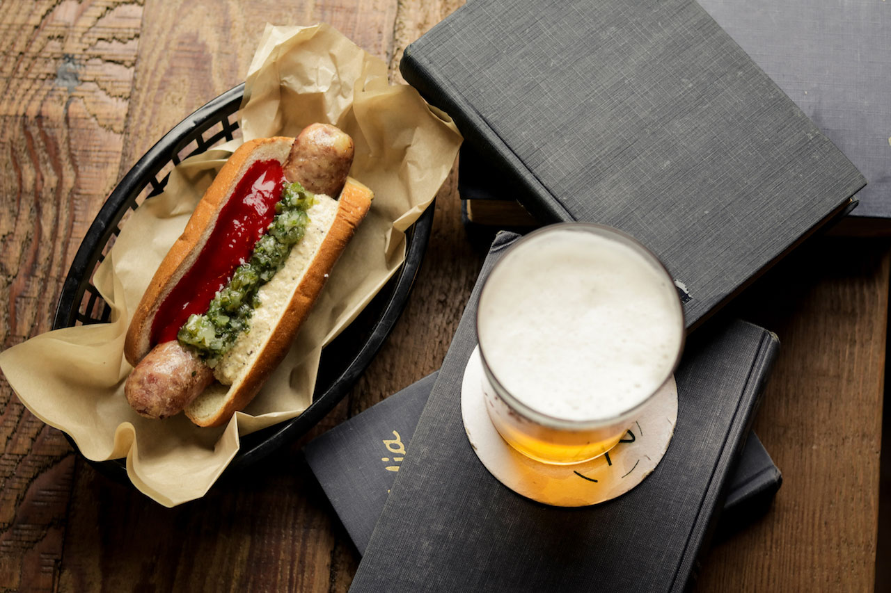 Shin's pork trotter hot dog and beer