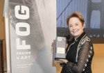 Alice Waters poses with her award, a fog machine.