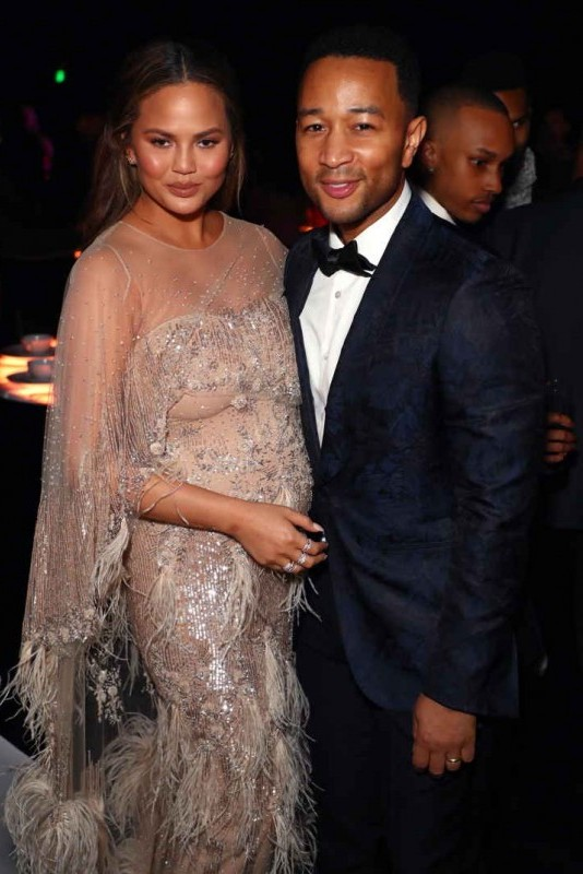 Chrissy Teigen (L) and John Legend attend The Art Of Elysium's 11th Annual Celebration