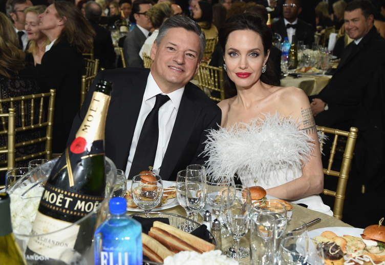 Businessman Ted Sarandos (L) and actor Angelina Jolie