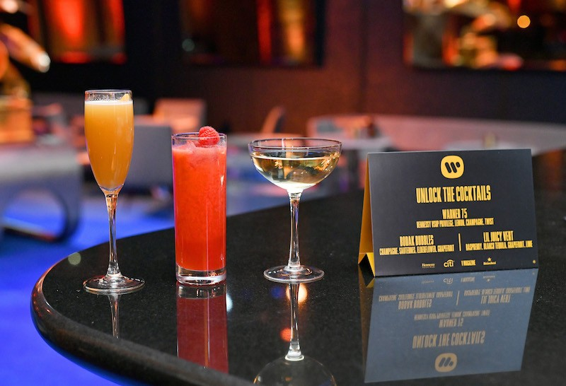 Beverages and a cocktail menu are displayed during the Warner Music Group Pre-Grammy Party in association with V Magazine.