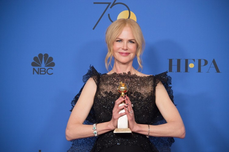"""After winning the category of BEST PERFORMANCE BY AN ACTRESS IN A LIMITED SERIES OR A MOTION PICTURE MADE FOR TELEVISION for her role in """"Big Little Lies,"""" actress Nicole Kidman poses backstage in the press room with her Golden Globe Award at the 75th Annual Golden Globe Awards at the Beverly Hilton"""