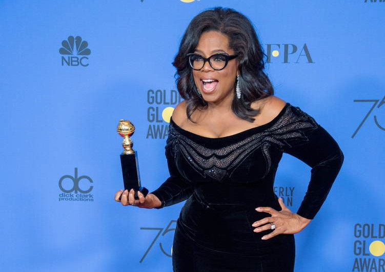"Oprah Winfrey poses backstage in the press room with the Cecil B. DeMille Award for her ""outstanding contribution to the entertainment field"" at the 75th Annual Golden Globe Awards at the Beverly Hilton"