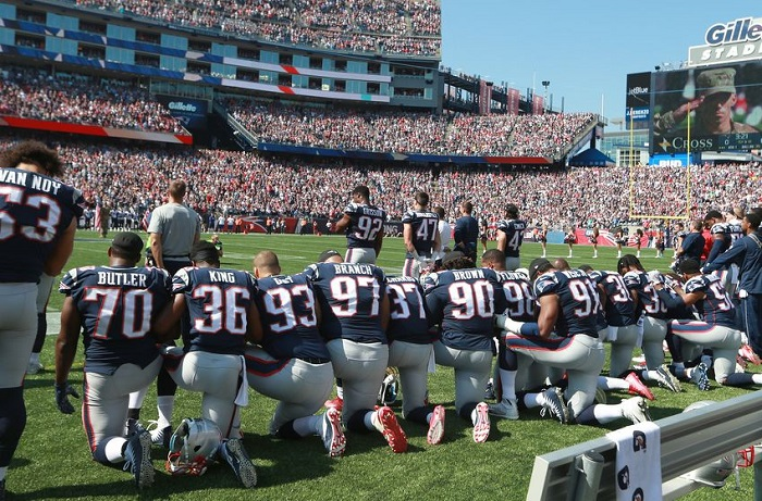 Some Patriots take a knee