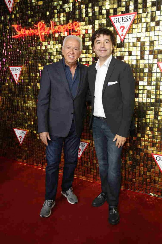 Fashion designer and co-founder of Guess? Inc. Paul Marciano (L) and Victor Herrero