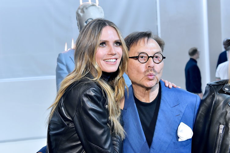 Heidi Klum and Michael Chow share a moment during the Mr Chow 50 Years party on February 16