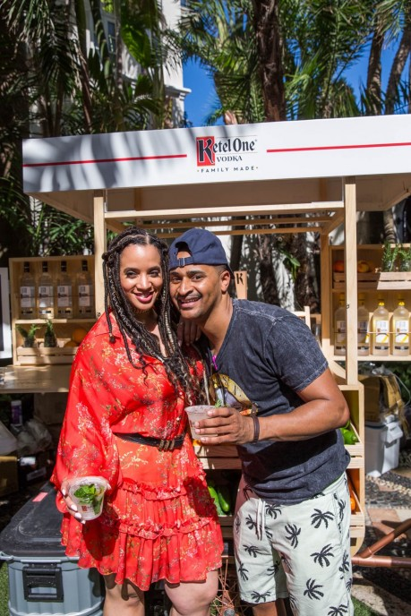 At the Ketel Market, actress Dascha Polanco and Chef JJ Johnson enjoy Ketel Soda cocktails at New Taste of South Beach hosted by Ketel One Family-Made Vodka and Wine N Dine.