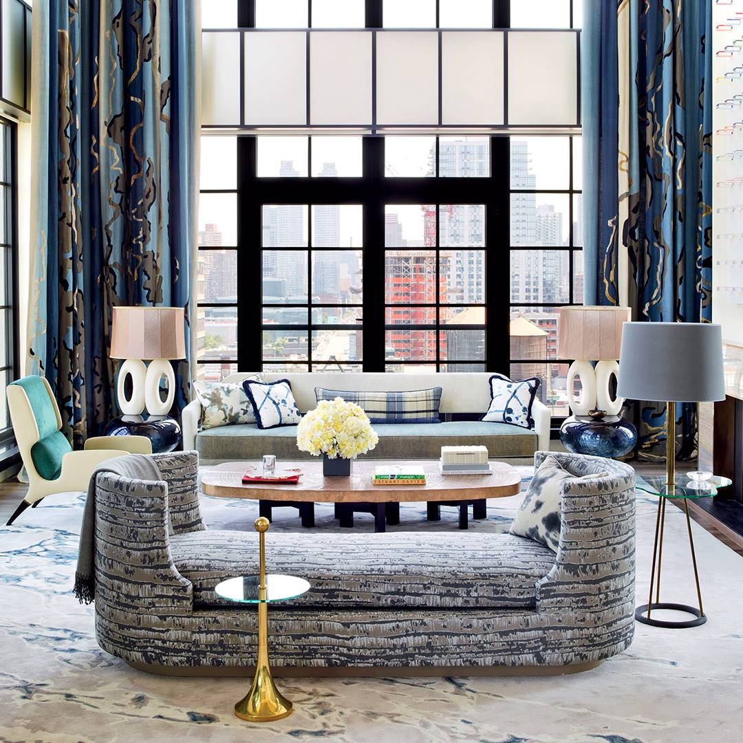 A blue-hued living room designed by Jean Louis Denoit with pieces from Decaso.