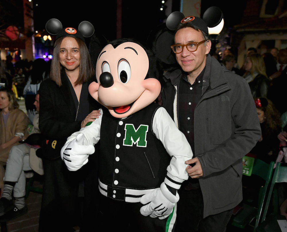 "ANAHEIM, CA - MARCH 07: (L-R) Maya Rudolph, Mickey Mouse and Fred Armisen attend the launch of ""Mickey the True Original"" campaign in celebration of Mickey's 90th anniversary with a fashion show featuring a Mickey-inspired collection by Opening Ceremony at Disneyland on March 7, 2018 in Anaheim, California. (Photo by Neilson Barnard/Getty Images for Disney)"