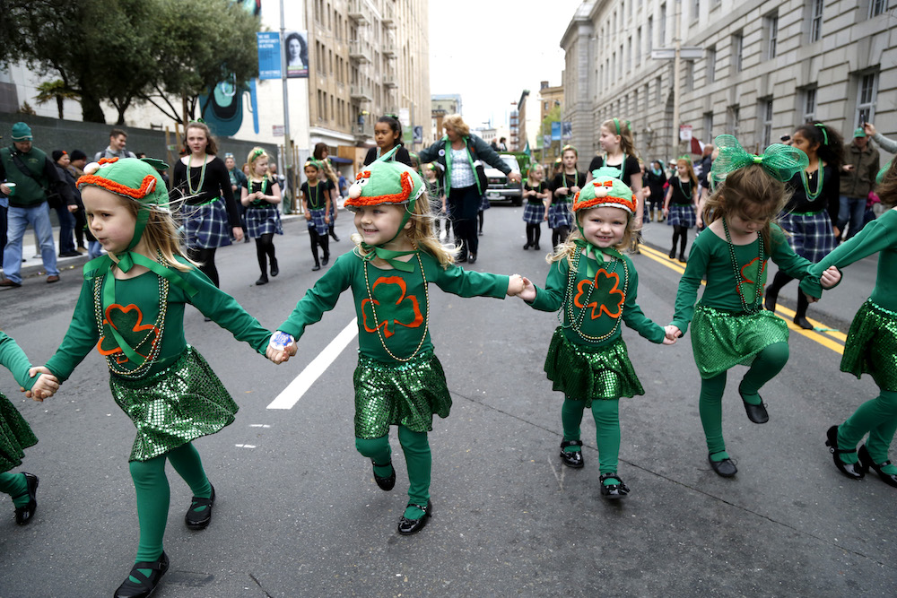 Irish Dancers walk down Market Street at the annual Saint Patrick's Day Parade