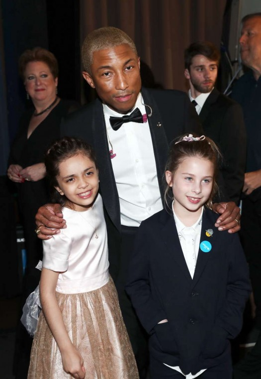 Bana al-Abed (L) and Pharrell Williams