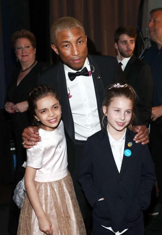 Bana al-Abed (L) and Pharrell Williams
