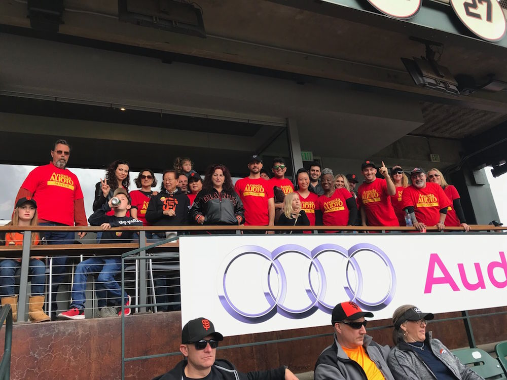 Alioto (center black jacket) and supporters at a recent Giants game