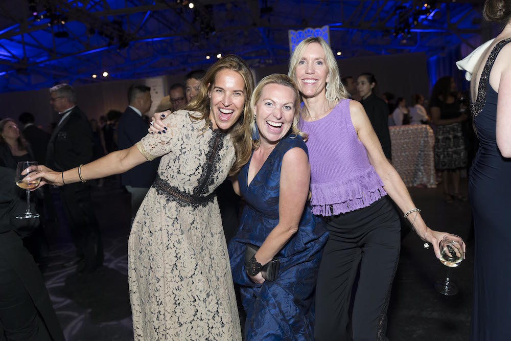 Stephanie Tomao, Sophie Dolan and Joan Merryman dance the night away