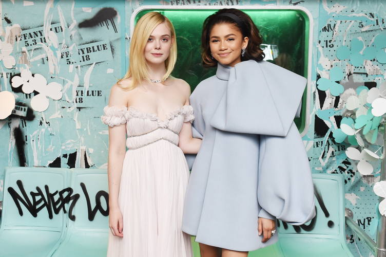 Elle Fanning (L) and Zendaya