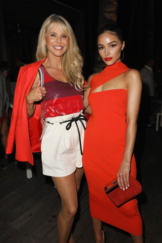 Christie Brinkley and Olivia Culpo attend the 2018 Sports Illustrated Swimsuit show at PARAISO during Miami Swim Week at The W Hotel South Beach