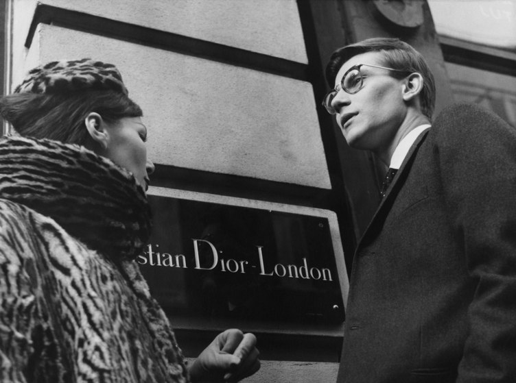 French fashion designer Yves Saint Laurent (1936 - 2008) in London, 11th November 1958. He is preparing for the following day's Dior Autumn collection show to an audience including Princess Margaret, at Blenheim Palace.