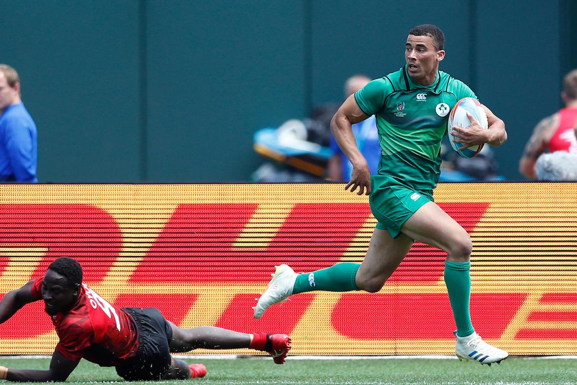 Ireland's Jordon Conroy drives through the Kenya defense for a try on day two of the Rugby World Cup Sevens