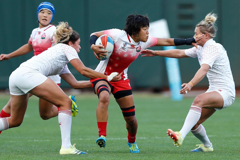 Japan look to break through England's defence on day two of the Rugby World Cup Sevens