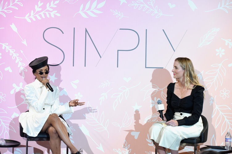 Graham chats with Who What Wear editor Kristen Marie Nichols onstage during the SIMPLY LA Fashion & Beauty Conference