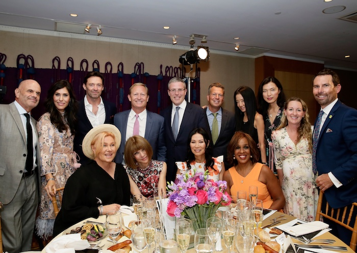At the table (seated left to right): Deborra -Lee Jackman, Anna Wintour, Wendi Deng Murdoch, Gayle King, (standing left to right): Irving Milgrom, executive assistant to Hugh Jackson, Cheryl Scharf, Hugh Jackman, Dan Faber, Y. David Scharf, Jeff Harrison, Director of Development, USTA Foundation, Vera Wang, art expert Xin Li of Christie's, Dana Garner, and Chris Garner, tennis coach for Anna Wintour