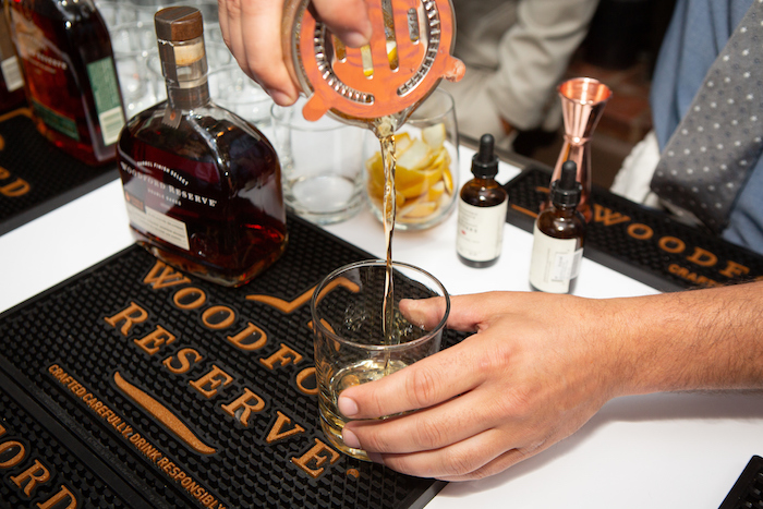 Pouring an Old Fashioned cocktail with Woodford Reserve Bourbon at Carnitas Tostadas with Tomatillo Salsa at the kick-off event for the James Beard Foundation's Taste America's 10-city national event.