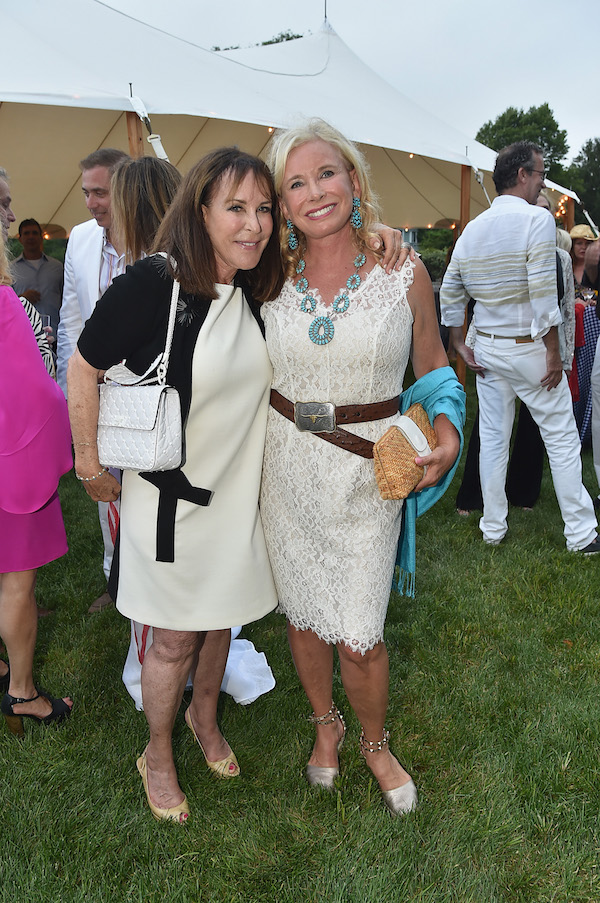 Andy Stark and Sharon Bush attend the RitaHayworthGala Hamptons Kickoff Event hosted by Alzheimer's Associationat Private Residence on August 3, 2018 in Water Mill, New York.