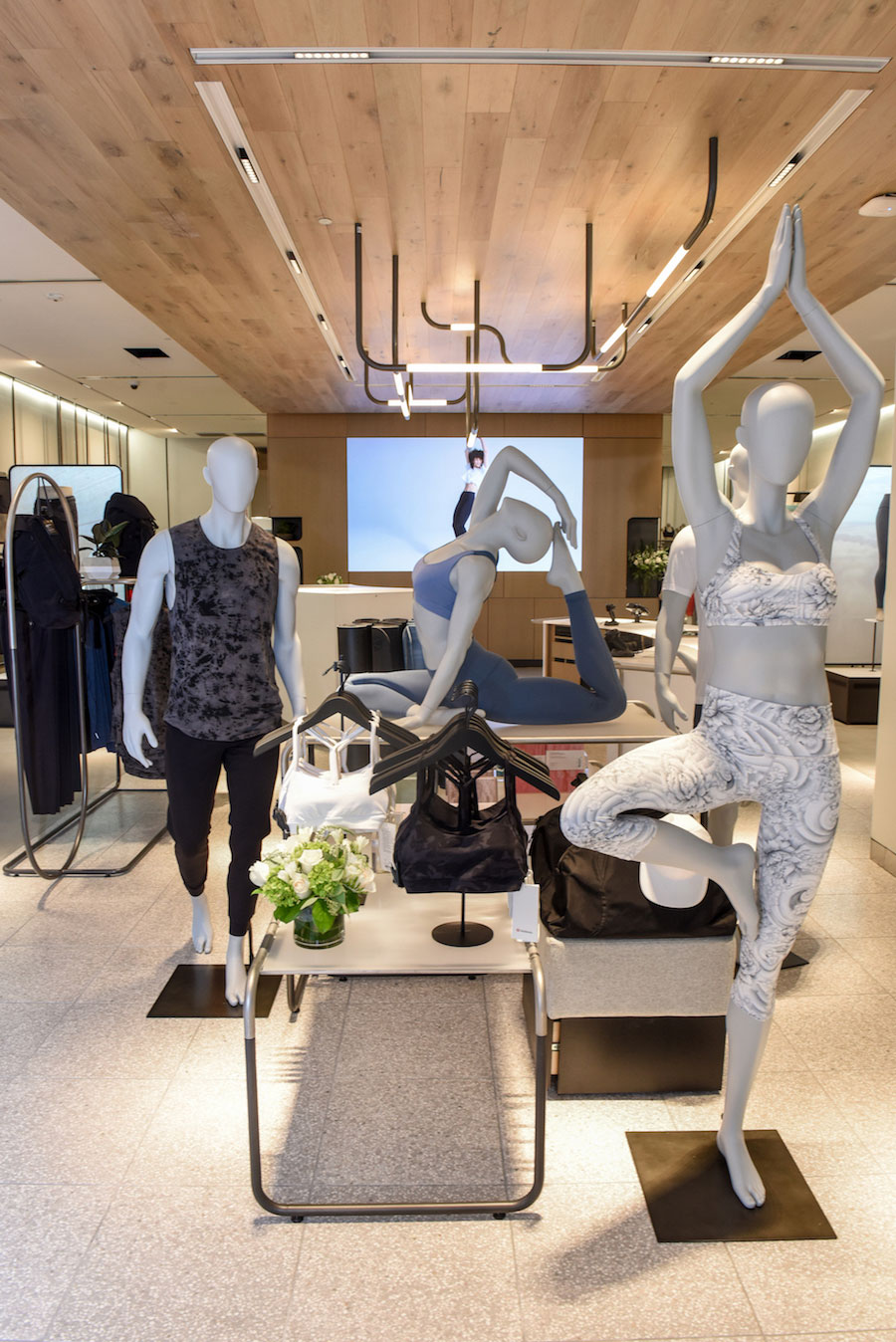 The mannequins at the new store are in more active positions than traditional mannequins.