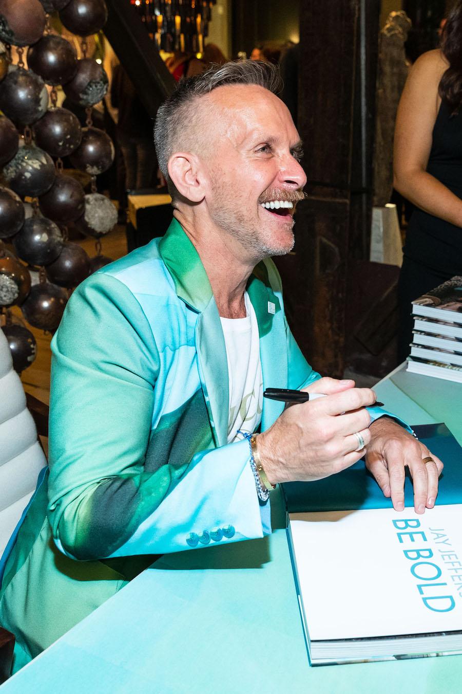 Jeffers signs books