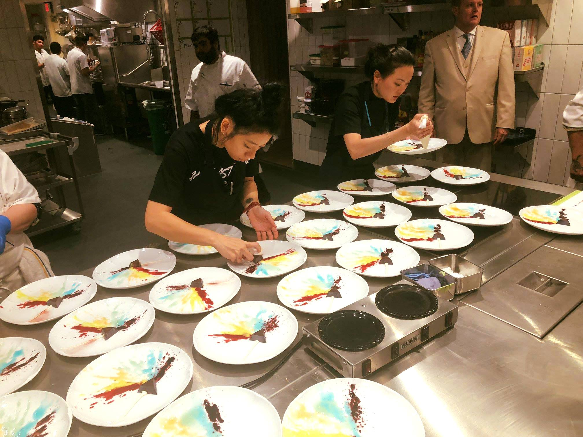 "The Gaggan team plating ""The Dark Side of the Moon""-inspired dessert"