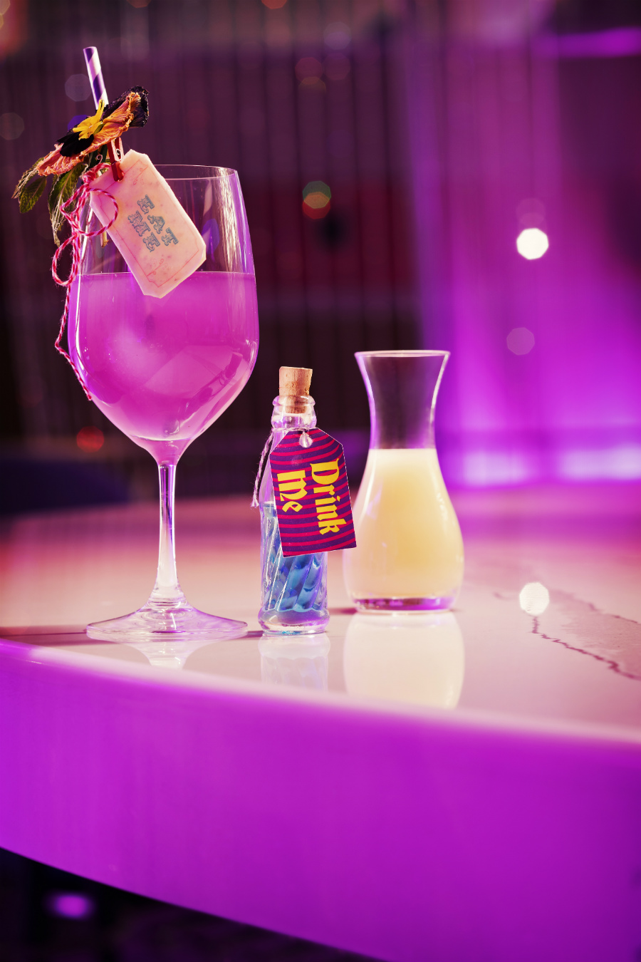 """Mercer's """"Alice in Wonderland""""-inspired We're All Mad Here cocktail incorporates color-changing Empress Indigo Gin, which changes colors right before your eyes."""