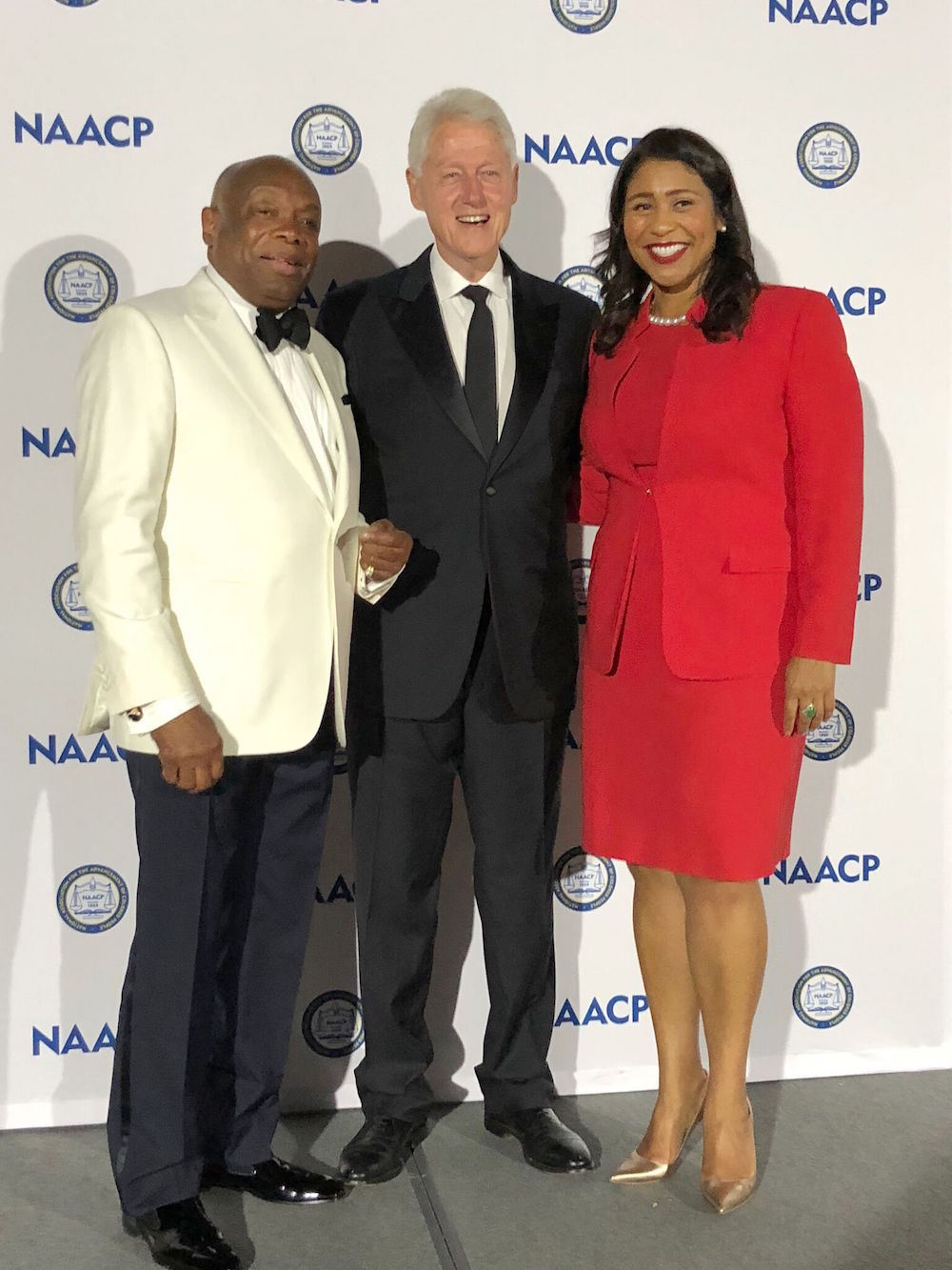 Breed with former mayor Willie Brown and President Bill Clinton at an NAACP event in July