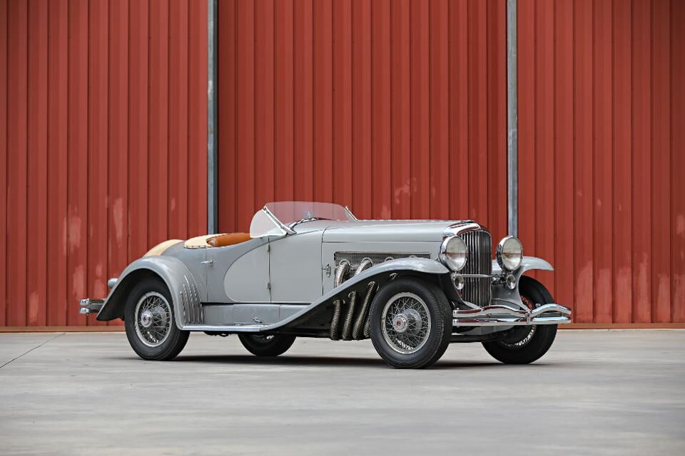 A 1935 Duesenberg SSJ Roadster set the record for American car sold at RM Sotheby's for $22 million. The car was formerly owned by actor Gary Cooper.
